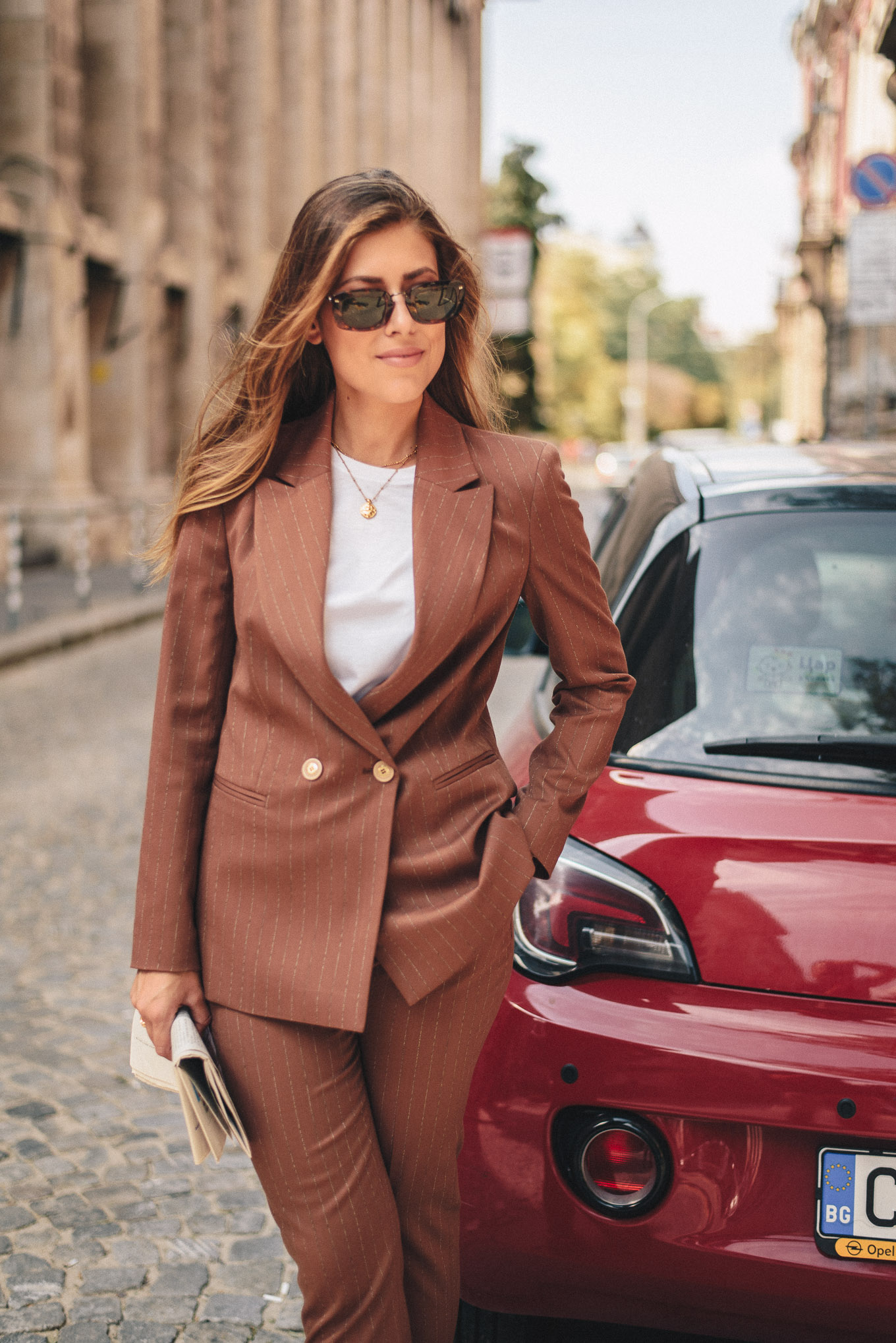 wearing brown suit in the city