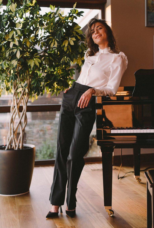 Juli wearing silk blend shirt