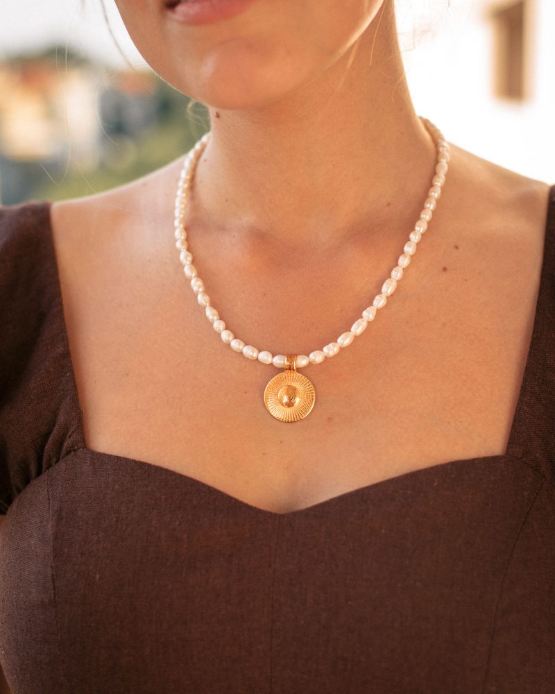 Necklace with gold medallion